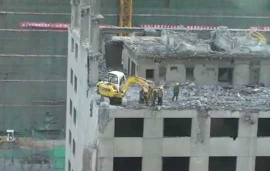 Building Demolition From The Top With Excavator - Only In China