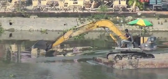 In Case You Didn't Know: Excavators Can Row a Boat