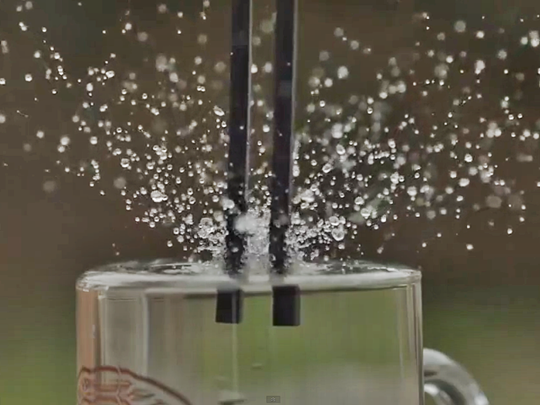 Tuning fork, water, slow motion,