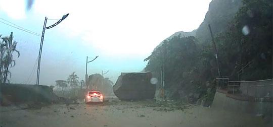 Car Survives Landslide and Falling Boulder