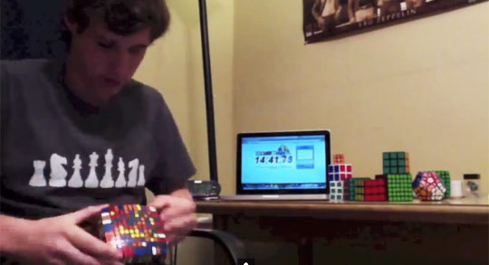Dude Solves 11x11x11 Rubik's Cube in 123 Minutes