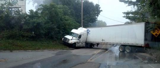 Truck Driver Fails to Make a U-Turn Near a Low Bridge
