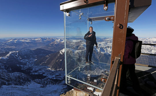 Glass Room Suspended Above the Alpes