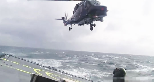 Helicopter Landing on a Ship in Rough Sea