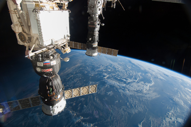 Russian Soyuz (left) and Progress (right) spacecraft docked to the International Space Station