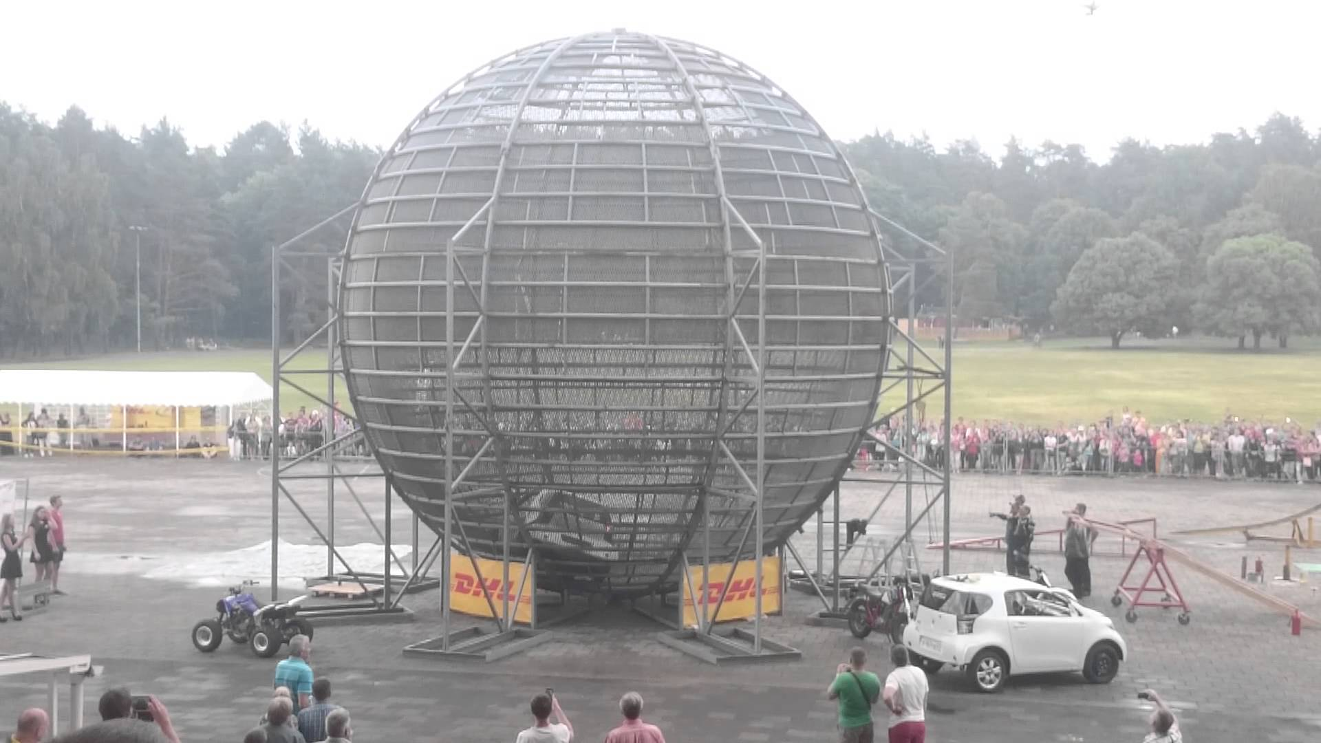 Car driving in a loop inside a death cage ball just ignores gravity
