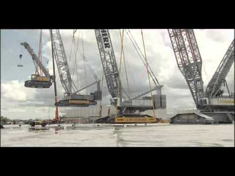 A giant crane lifting a huge crane lifting a big crane lifting a crane