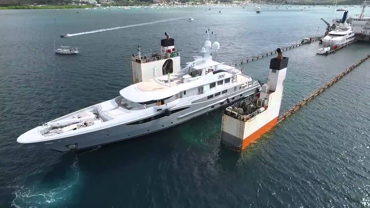 This ship partially submerges itself to load superyachts