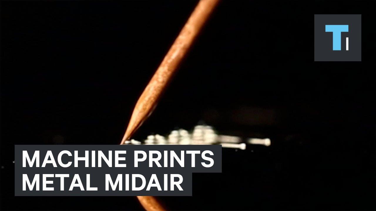 Machine prints metal midair