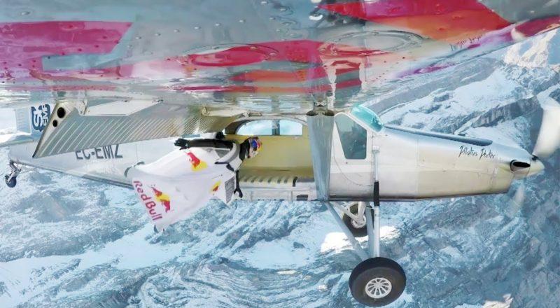 Dudes wingsuit fly into an open plane door