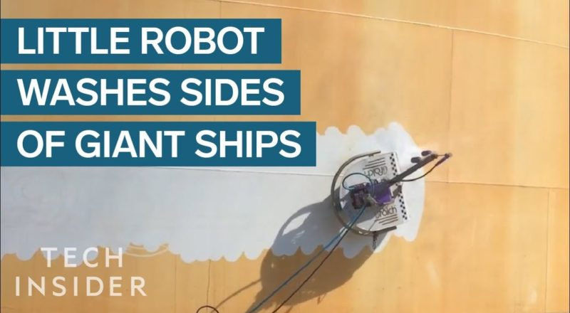 Little Robot Washes Sides Of Giant Ships